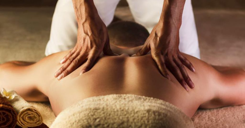 Man getting back and neck massage