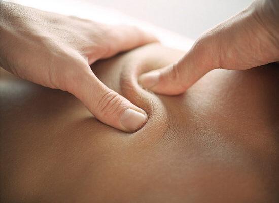 Person receiving deep tissue massage